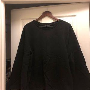 Banana Republic bell-sleeved black sweatshirt.